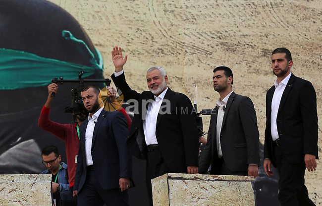 Chairman of the political bureau of the Hamas Palestinian Islamist movement, Ismail Haniyeh waves during a rally marking the 31th anniversary of the founding of the Hamas movement, in Gaza city, December 16, 2018. Photo by Ashraf Amra