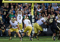 Running back Amir Carlisle (3) leaps to catch an overthrown long snap on Notre Dame's opening possession.