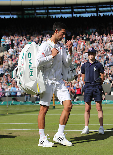 02.07.2016. All England Lawn Tennis and Croquet Club, London, England. The Wimbledon Tennis Championships Day Six. Number 1 seed, Novak Djokovic (SRB) leaves number 1 Court after he loses his match in four sets to Sam Querry (USA).