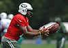Geno Smith #7, New York Jets quarterback, takes a snap during training camp at Atlantic Health Jets Training Center in Florham Park, NJ on Saturday, Aug. 13, 2016.