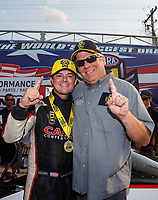 Sep 4, 2017; Clermont, IN, USA; NHRA top fuel driver Steve Torrence celebrates with RFC pastor Craig Garland after winning the US Nationals at Lucas Oil Raceway. Mandatory Credit: Mark J. Rebilas-USA TODAY Sports