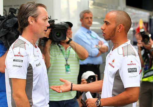 15.03.2012. Melbourne, Australia.  British Formula One driver Lewis Hamilton (R) of McLaren Mercedes speaks with sporting direktor of McLaren Mercedes, Australian Sam Michael, at the paddock before the Australian Formula 1 Grand Prix at the Albert Park circuit in Melbourne, Australia, 15 March 2012. The Formula One Grand Prix of Australia will take place on 18 March 2012.