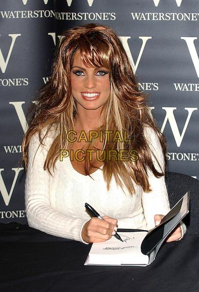 "JORDAN - KATIE PRICE.Signs copies of her updated autobiography ""Jordan: A Whole Different Story"" at Waterstones Oxford Street, London, UK..February 1st, 2006.Ref: BEL.half length white top signing autograph.www.capitalpictures.com.sales@capitalpictures.com.© Capital Pictures."