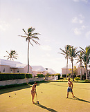 BERMUDA, Cambridge Resort, couple playing in croquet lawn in resort