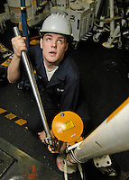 060120-N-7981E-006 Pacific Ocean (January 19, 2006)- Aviation Support Equipment Technician Airman Chris Cunningham of Washington adjusts the footing on an aircraft jack stand in the hangar bay of the Nimitz-class aircraft carrier USS Abraham Lincoln (CVN-72). Lincoln is currently underway off the coast of California. U.S. Navy photo by Photographer's Mate Airman Aprrentice James R. Evans (RELEASED)