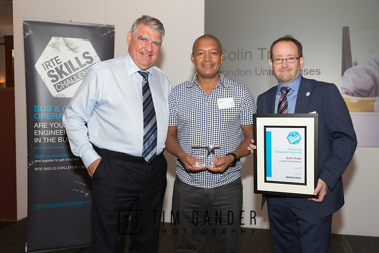 17/07/2015 The IRTE Skills Challenge 2015 prize-giving takes place at The National Motorcycle Museum, Birmingham. Sir Moir Lockhead (left) presents the Runner Up Bodywork Technician Colin Truter of RATP with his trophy with sponsor Matthew Millington (right) of Bridgestone.