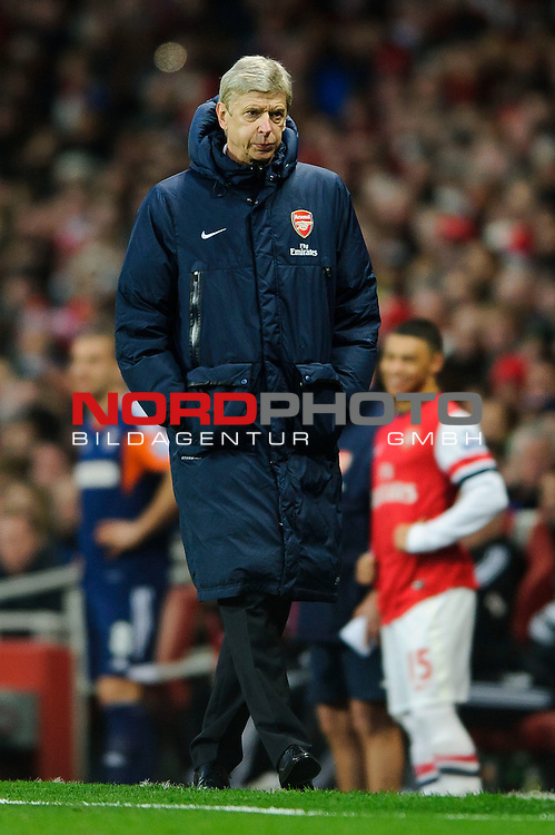 Arsenal Manager Arsene Wenger (FRA) looks on from the touchline during the match -  - 18/01/14 - SPORT - FOOTBALL - Emirates Stadium - Arsenal v Fulham - Barclays Premier League.<br /> Foto nph / Meredith<br /> <br /> ***** OUT OF UK *****