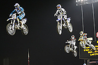 01/22/11 Los Angeles, CA:  Riders fly through the air during the 1st ever AMA Supercross held at Dodger Stadium.