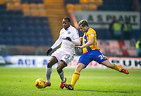 Myles Weston of Wycombe Wanderers & Ashley Hemming of Mansfield Town during the The Checkatrade Trophy  Quarter Final match between Mansfield Town and Wycombe Wanderers at the One Call Stadium, Mansfield, England on 24 January 2017. Photo by Andy Rowland.