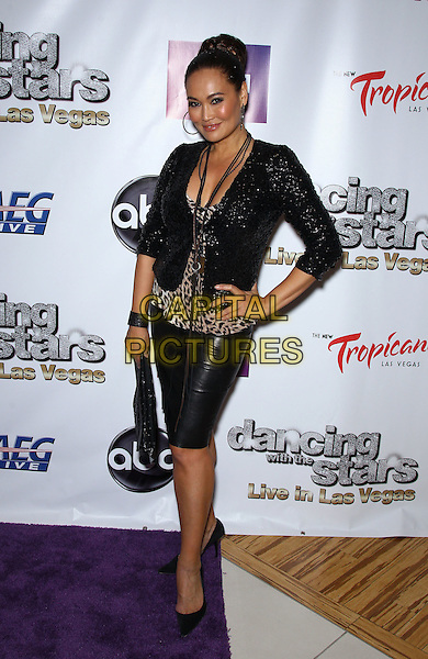 Tia Carrere.Dancing With The Stars: Live in Las Vegas, Media Preview and Red Carpet at the Tropicana Theater in The New Tropicana Hotel and Casino, Las Vegas, Nevada, USA, 13th April 2012..full length black sequined sequin jacket hand on hip  leopard print animal leather skirt  .CAP/ADM/MJT.© MJT/AdMedia/Capital Pictures.