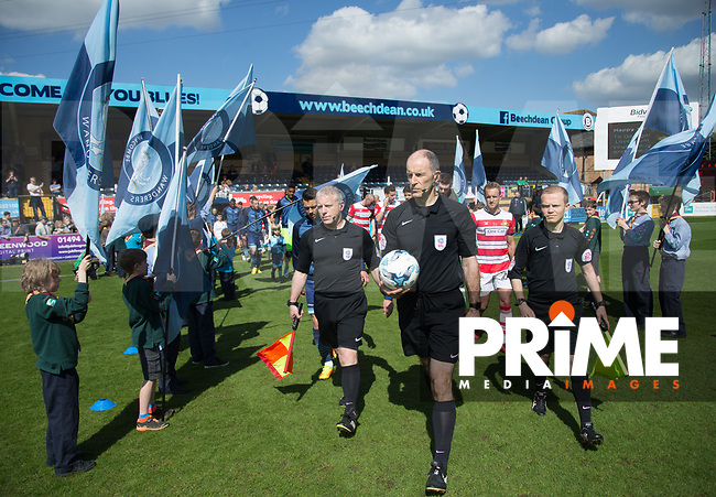 The players enter Adams Park during the Sky Bet League 2 match between Wycombe Wanderers and Doncaster Rovers at Adams Park, High Wycombe, England on 22 April 2017. Photo by James Williamson / PRiME Media Images.