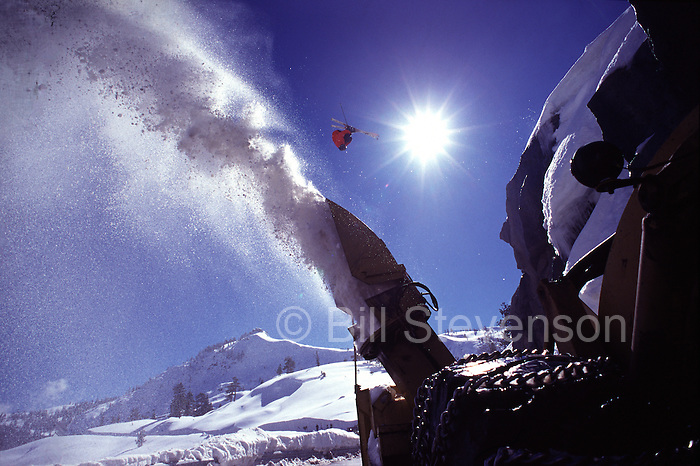 A photo of a man jumping a road gap while skiing on Donner Summit, CA.
