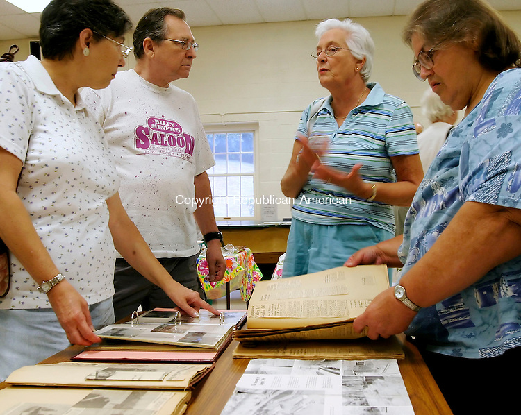 OXFORD, CT - 11 AUGUST 2005 -081105JS02-- Virginia Kiehl of Oxford, third from left, talks about her experience during the 1955 flood as Pat Gadsky of Oxford, left, her husband Walt, second from left and Gladys Higginson of Southbury look over family scrapbooks during an historical program about the flood Thursday at Oxford Town Hall. Keihl had an aerial photo of her family's home and truck underwater at the Beacon Falls trailer park. The program was presented by the Oxford Historical Society.    --Jim Shannon Photo--Maple Bank Farm in Roxbury  are CQ