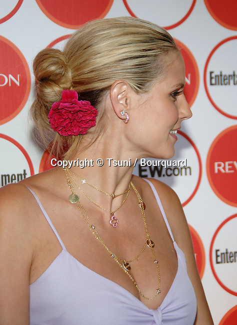 Heidi Klum arriving at the Entertainment Weekly 4th Annual Pre-Emmy Party at the Republic Club  in Los Angeles. August 26, 2006.<br /> <br /> headshot<br /> full length<br /> smile<br /> eye contact<br /> over the shoulder