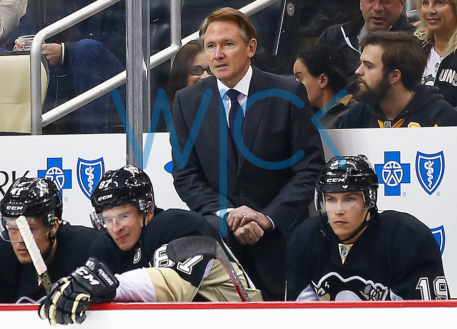 Head coach Mike Johnston of the Pittsburgh Penguins looks on against the Los Angeles Kings during the game at Consol Energy Center in Pittsburgh, Pennsylvania on December 11, 2015. (Photo by Jared Wickerham / DKPS)