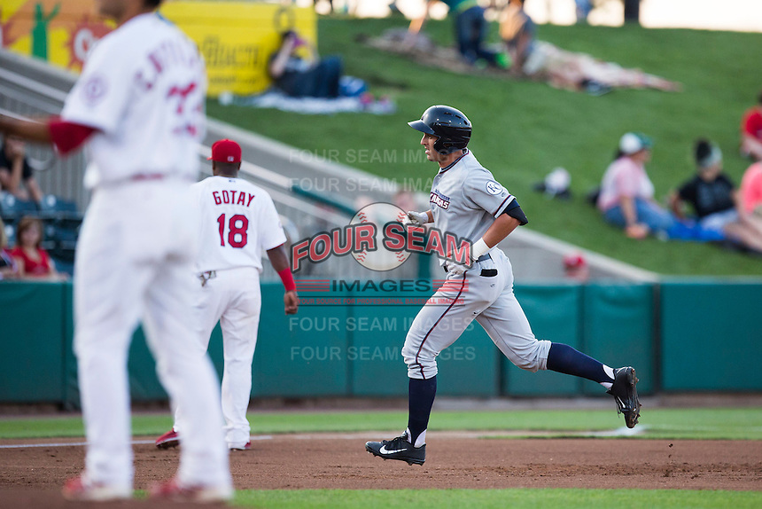 Lane Adams (8) of the Northwest Arkansas Naturals rounds the bases after hitting a home run during a game against the Springfield Cardinals at Hammons Field on August 20, 2013 in Springfield, Missouri. (David Welker/Four Seam Images)
