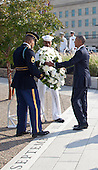 United States President Barack Obama lays a wreath at the Pentagon to mark the 13th anniversary of the September 11th, 2001 terrorist attacks, in Washington, Thursday, September 11, 2014.<br /> Credit: Martin Simon / Pool via CNP