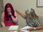 Katherine Darragh, left, listens as President & Ceo Isabelle Rodriguez Wilson explains the details and amount of her scholarship during the Nevada Women's Fund Scholarship distribution, June 20, 2019.