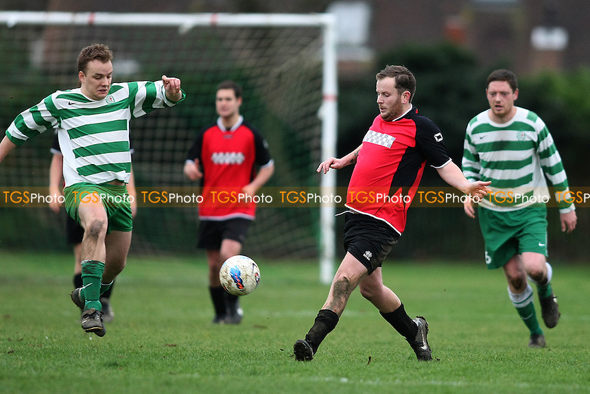 Saint Augustines (Green and White hoops) v Chequers - Essex Sunday Corinthian League Football - 08/01/12 - MANDATORY CREDIT: George Phillipou/TGSPHOTO - Self billing applies where appropriate - 0845 094 6026 - contact@tgsphoto.co.uk - NO UNPAID USE.