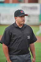 Umpire Ethan McCranie handles the calls on the bases during the game between the Ogden Raptors and the Idaho Falls Chukars at Lindquist Field on July 2, 2018 in Ogden, Utah. The Raptors defeated the Chukars 11-7. (Stephen Smith/Four Seam Images)