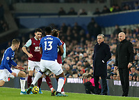 26th December 2019; Goodison Park, Liverpool, Merseyside, England; English Premier League Football, Everton versus Burnley; Everton Manager Carlo Ancelotti  and Burnley Manager Sean Dyche  look on as Yerry Mina of Everton challenges James Tarkowski of Burnley for the ball  - Strictly Editorial Use Only. No use with unauthorized audio, video, data, fixture lists, club/league logos or 'live' services. Online in-match use limited to 120 images, no video emulation. No use in betting, games or single club/league/player publications