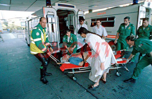 Paramedics and ambulance crews rush the victim of a heart attack into the crash room of an accident and emergency department. Doctors and nurses are standing by to deal with the patient straightaway. This image may only be used to portray the subject in a positive manner..©shoutpictures.com..john@shoutpictures.com