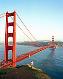 USA, California, Marin Headlands, woman hiking near Golden Gate Bridge, Marin Headlands