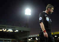The linesman with the Carrow Road floodlight behind hum during the Barclays Premier League match between Norwich City and Swansea City played at Carrow Road, Norwich on November 7th 2015