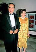 United States Senate Minority Leader Bob Dole (Republican of Kansas) and his wife, US Secretary of Labor Elizabeth Hanniford Dole, arrive for the State Dinner in honor of President Mikhail Gorbachev of the Union of Soviet Socialist Republics, at the White House in Washington, DC on Thursday, May 31, 1990. <br /> Credit: Ron Sachs / CNP