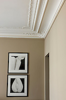In a corner of the master bedroom a pair of black and white framed photographs by Eric Marrian take pride of place
