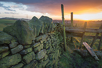 The stile at the footpath from New Houses to Scouthead at sunset, Saddleworth, Greater Manchester.