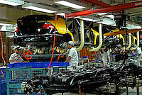 Workers on the production line of the Honda Accord at the new Guangzhou Honda Automobile Co. Ltd factory. The plant built at a cost of 140 million US$ is one of the most advanced car plants in the world. It has a state of the art production line as well as the world's first total water re-cycling sytem..