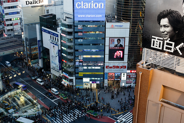 Tokyo, December 2012 - Advertising in Shibuya with a crossing in the background.