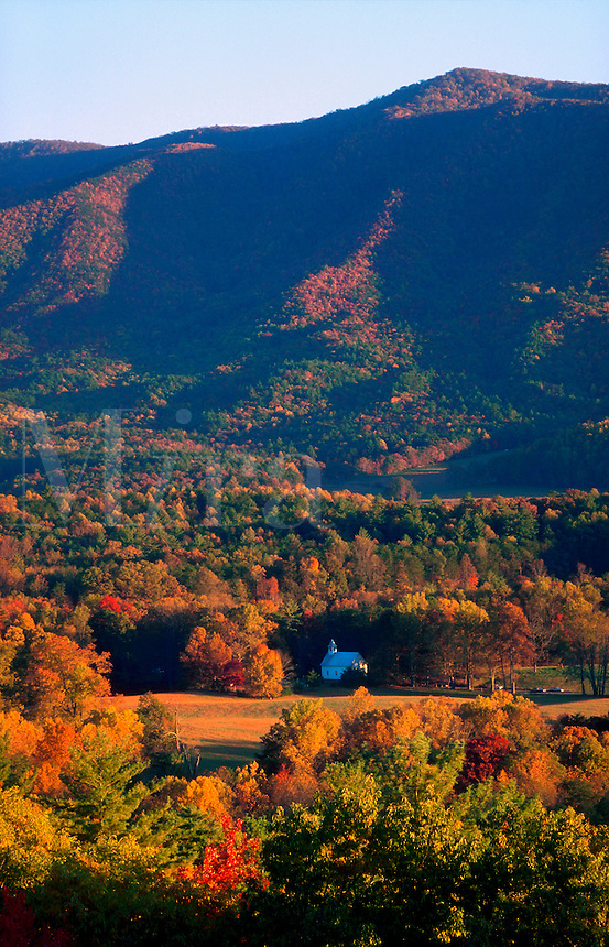 Country church in autumn landscape, New England