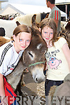 Shaena Maher and Julia O'Neill falling for the cute donkeys at the horse fair in Killorglin on Saturday   Copyright Kerry's Eye 2008