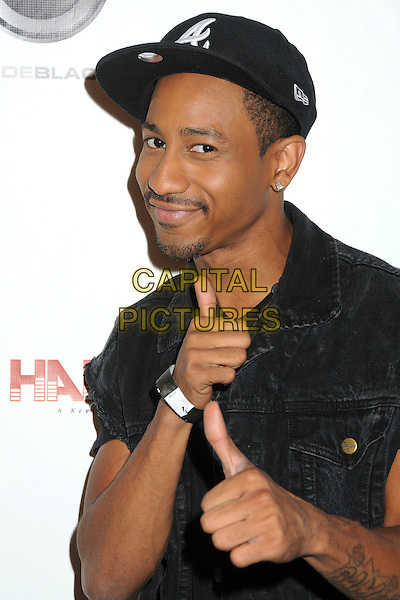 "Brandon T. Jackson.Kevin Hart's ""Laugh At My Pain"" Los Angeles Premiere held at the Pacific Design Center, West Hollywood, California, USA..September 7th, 2011.half length jeans denim black jacket hand headshot portrait baseball cap hat goatee facial hair thumbs up.CAP/ADM/BP.©Byron Purvis/AdMedia/Capital Pictures."