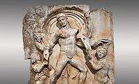 Roman Sebasteion relief  sculpture of Emperor Claudius as God of sea and land,  Aphrodisias Museum, Aphrodisias, Turkey. <br /> <br /> The Emperor as god Claudius strides forward in a divine epiphany, drapery billowing around his head. He receives a cornucopia with fruits of the earth from a figure emerging from the ground, anda ship's steering oar from a marine tritoness with fish legs. The idea is clear: the god-emperor guarantees the prosperity of land and sea. The relief is a remarkable local visualisation - elevated and panegyrical - of the emperor's role as a universal saviour and divine protector.