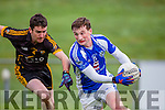 Stephen O'Sullivan Templenoe goes past Kevin McMahon Coolmeen during the Munster Junior football final in Mallow on Sunday