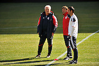 New York Red Bulls head coach Hans Backe (L) talks with assistant coach Jan Halvor Halvorsen (C) and  individual development coach Mike Petke (R) during practice on Media Day at Red Bull Arena in Harrison, NJ, on March 15, 2011.