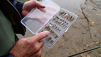 NWA Democrat-Gazette/FLIP PUTTHOFF <br /> Henderson shows some of the flies he ties for trout fishing      Oct. 8 2016     below Beaver Dam.
