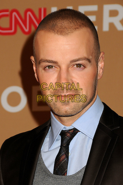 JOEY LAWRENCE .CNN Heroes: An All-Star Tribute 2010 held at the Shrine Auditorium, Los Angeles, California, USA, .20th November 2010..portrait headshot brown suit tie grey gray .CAP/ADM/BP.©Byron Purvis/AdMedia/Capital Pictures.
