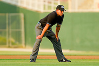 Umpire Roberto Ortiz handles the calls on the bases during the South Atlantic League game between the Delmarva Shorebirds and the Kannapolis Intimidators at Fieldcrest Cannon Stadium on May 23, 2011 in Kannapolis, North Carolina.   Photo by Brian Westerholt / Four Seam Images
