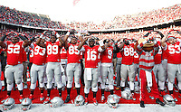 Ohio State Buckeyes quarterback J.T. Barrett (16), center, and the rest of the Ohio State Buckeyes sing the school's alma mater Carmen Ohio after the college football game between the Ohio State Buckeyes and the Indiana Hoosiers at Ohio Stadium in Columbus, Saturday afternoon, November 22, 2014. The Ohio State Buckeyes defeated the Indiana Hoosiers 42 - 27. (The Columbus Dispatch / Eamon Queeney)