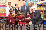 MUSIC TO THEIR EARS: A new music project 'Colour My Strings' was launched by Minister Jimmy Deenihan at Mercy Moyderwell Primary school on Monday morning. PIctured Front l-r were: Tobi Obadona, Aoibhin O'Connor MacCarthy, Amanda Ardleanova and Darragh O'Brien with Minister Deenihan. Back l-r were: Maire Jones (teacher), Lucy Tanner (Kerry School of Music), Hugh Colloty, Nick Moloney and Moira Quinlan (Principal).