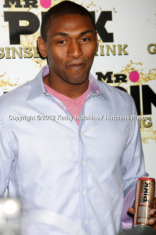 """LOS ANGELES - OCT 11:  Ron Artest aka Metta World Peace arrives at the """"Mr. Pink"""" Energy Drink Launch at Beverly Wilshire Hotel on October 11, 2012 in Beverly Hills, CA"""