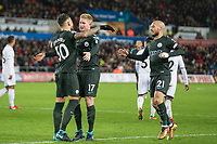 Kevin De Bruyne of Manchester City celebrates scoring his side's second goal with Nicolas Otamendi during the EPL - Premier League match between Swansea City and Manchester City at the Liberty Stadium, Swansea, Wales on 13 December 2017. Photo by Mark  Hawkins / PRiME Media Images.