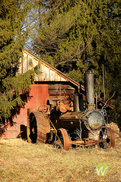 Paul Beard colonial farmstead, Warrensville Road, Williamsport, PA. Old rusting Peerless steam tractor.