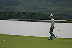 Seung-yul Noh lines up his putt on the first.on the final day of the 3 Irish Open, at the Killarney Golf and Fishing Club, Killarney, Ireland.Picture Fran Caffrey/www.golffile.ie.