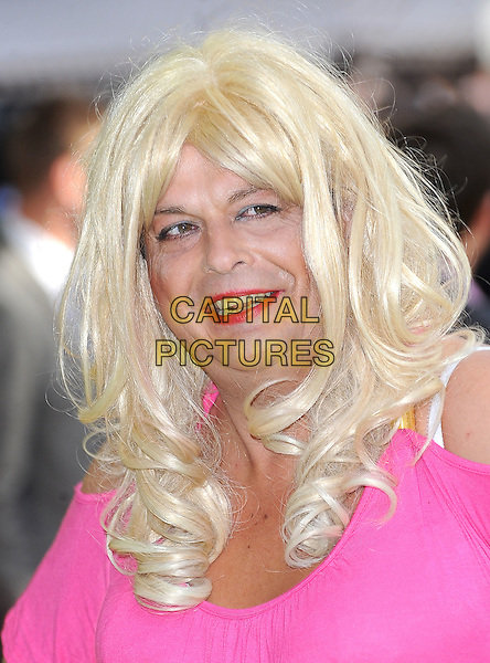 GUEST.European Premiere of 'Fire in Babylon' at the Odeon, Leicester Square, London, England, UK, May 9th 2011..headshot portrait pink blonde wig  cross-dresser .CAP/BEL.©Tom Belcher/Capital Pictures.