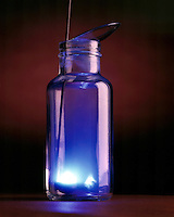 SULFUR BURNING IN OXYGEN<br /> (Variations Available)<br /> Sulfur In Deflagration Spoon  in Bottle of Oxygen<br /> Orthorhombic lump sulfur ignites in oxygen below 260 degC with a blue flame to form sulfur dioxide gas (SO2).  SO2 is slowly oxidized in the atmosphere to form SO3 which dissolves in rainwater to give sulfuric acid or acid rain.